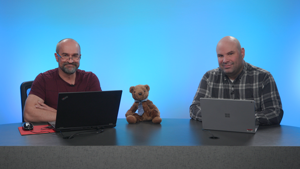 Shot of Peter Myers, Chris Finlan and Paginated Report Bear at a desk